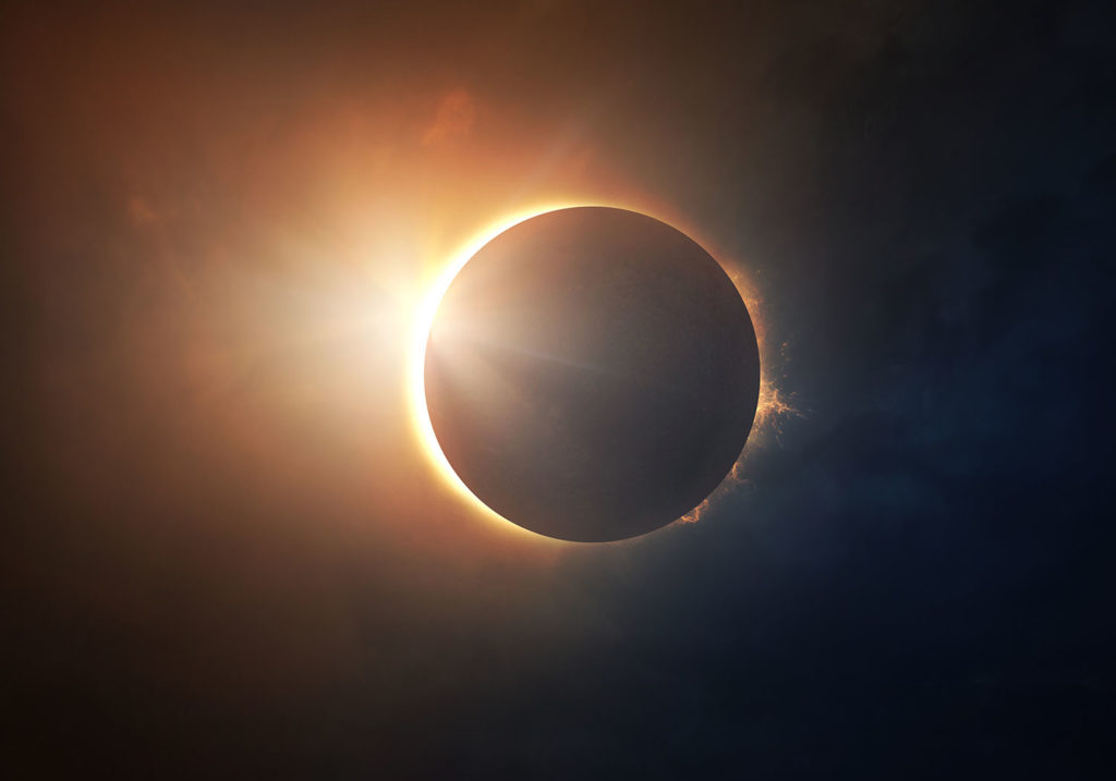 The moon covers the sun in a beautiful solar eclipse