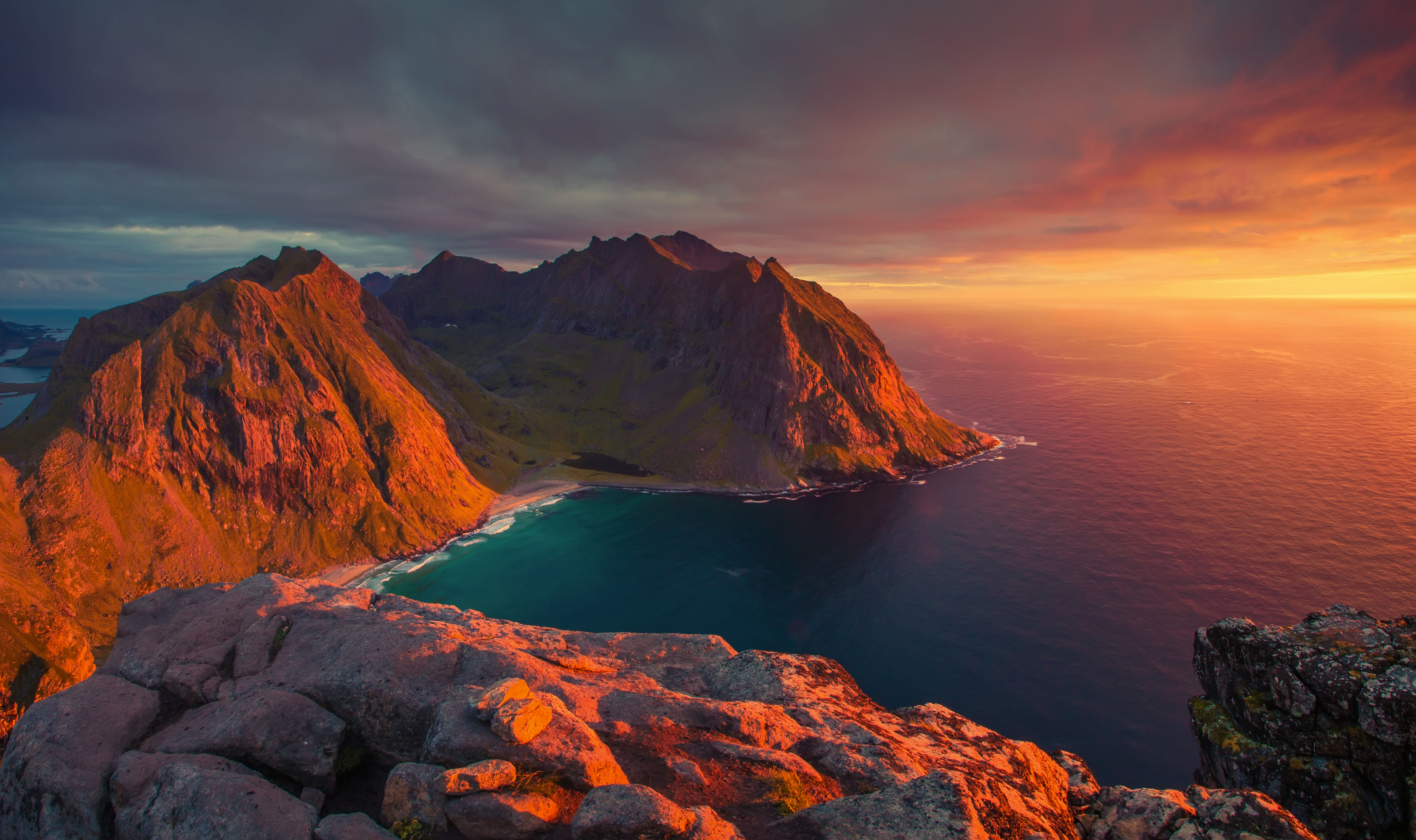 North sunset in Norway. Stunning sea view from mountains. Beautiful bay in evening sunlight. Lofoten islands landscape.